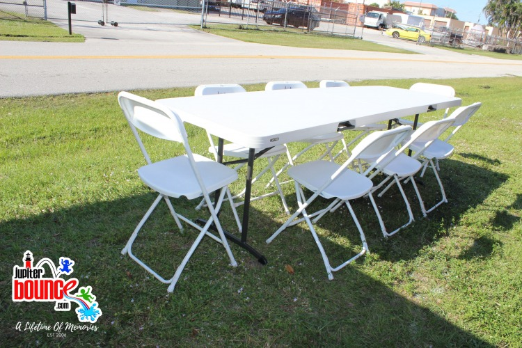 8' table with 10 folding chairs